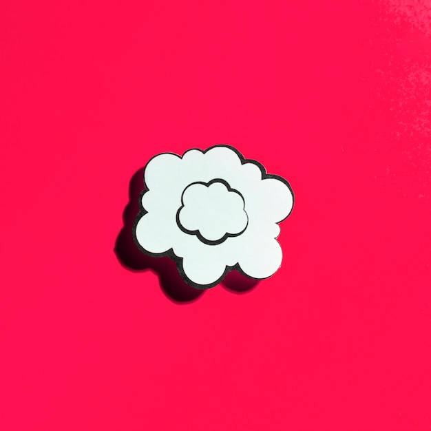 Cloud white speech bubble on red background Free Photo