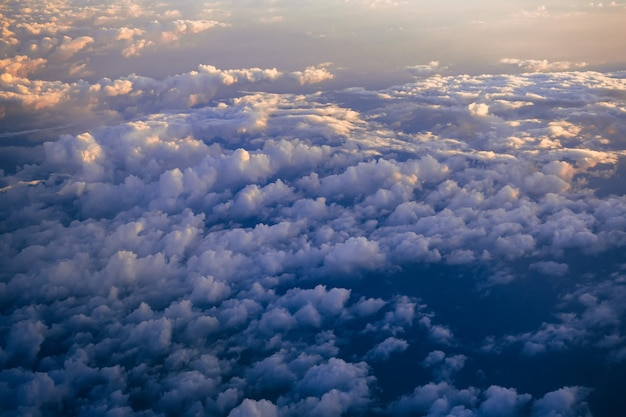 Clouds in the blue sky with sunlight from the plane Premium Photo