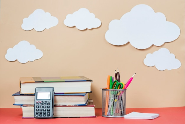Clouds near books and stationery Free Photo