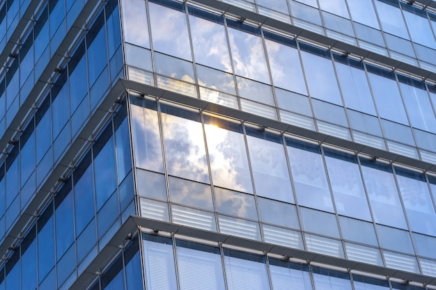 Clouds reflected in windows of a contemporary building Free Photo