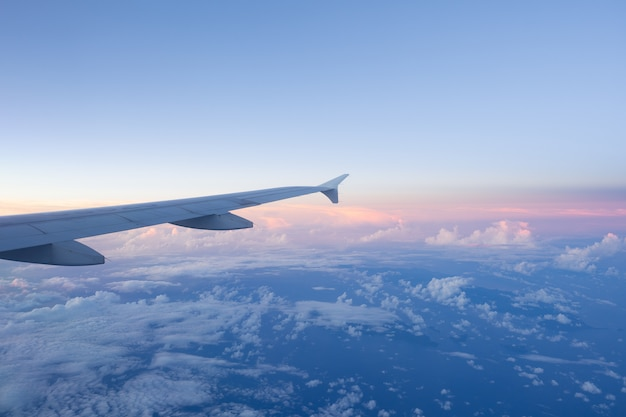 Clouds and sky as seen through window of an aircraft Premium Photo