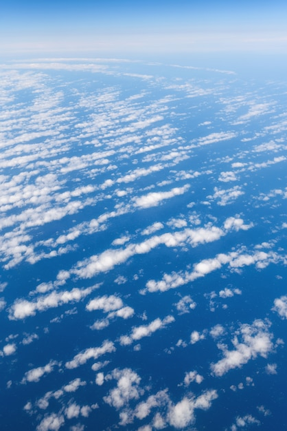 Clouds and sky view from airplane window. Premium Photo