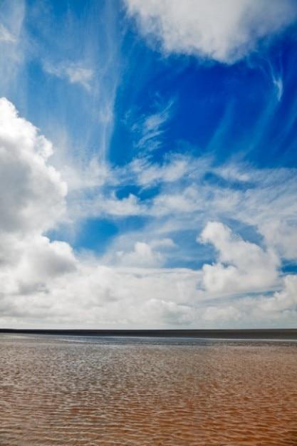 Cloudy beach scenery Free Photo