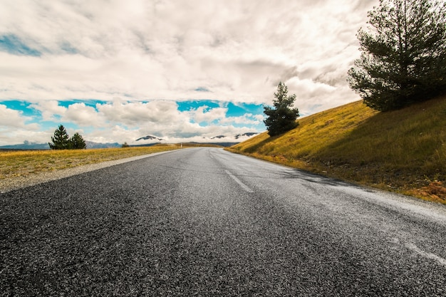 Cloudy day on the road Free Photo