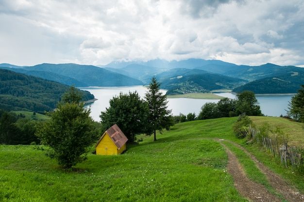 Cloudy landscape view from lake bicaz in romania Premium Photo