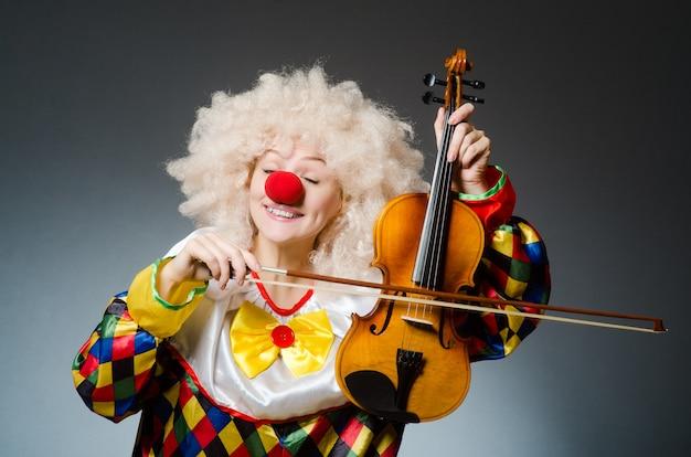 Clown in funny concept on dark background Photo | Premium Download