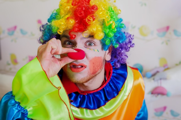 Clown pushes himself on the nose. Premium Photo