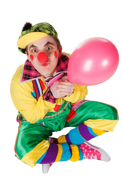 Clown with a balloon in a hand isolated on the white background Premium Photo