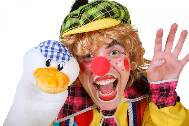 Clown with duck and makeup isolated on white background Premium Photo