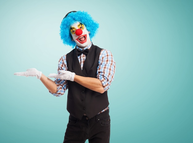 Clown with hands on hips and smiling Free Photo