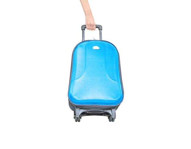 Clsoeup blue luggage with hand isolated on white background Premium Photo