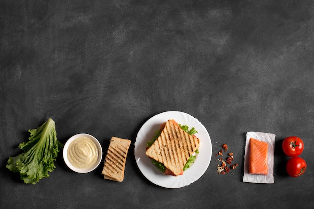 Club sandwich prepared with fish on the chalkboard Premium Photo