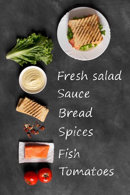 Club sandwich prepared with fish on the wooden board Premium Photo