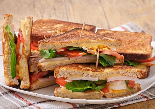 Club sandwich with chicken and ham Free Photo