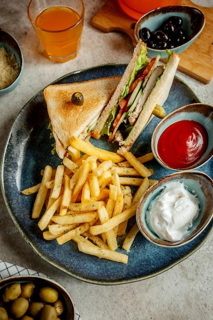 Club sandwich with potatoes Free Photo