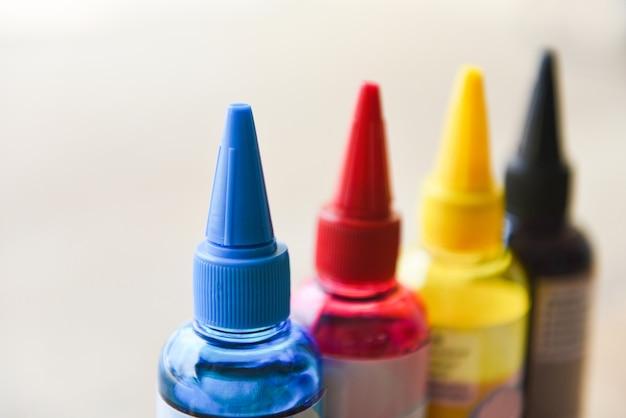 Cmyk ink bottle for printer machine Premium Photo