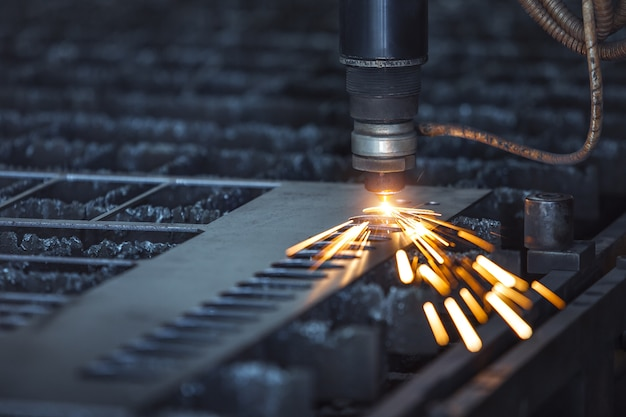 Cnc laser cutting of metal, modern industrial technology. small depth of field. Premium Photo