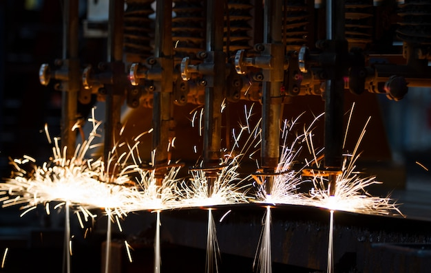 Cnc lpg cutting with sparks close up Premium Photo