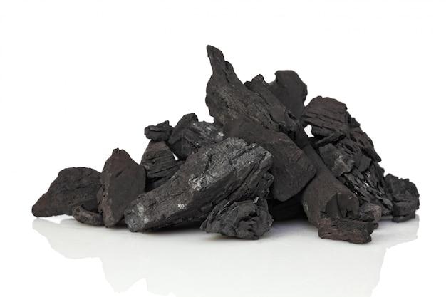 Coal on white Premium Photo