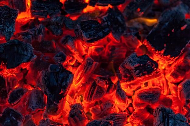 The coals of a campfire background Premium Photo