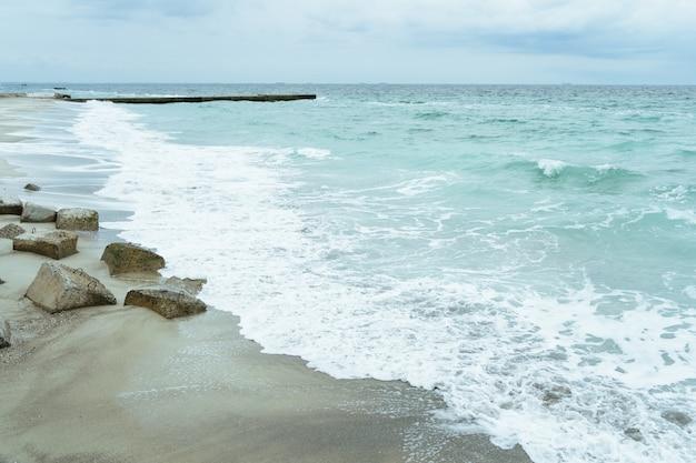 The coastline with concrete slabs on the shore Premium Photo