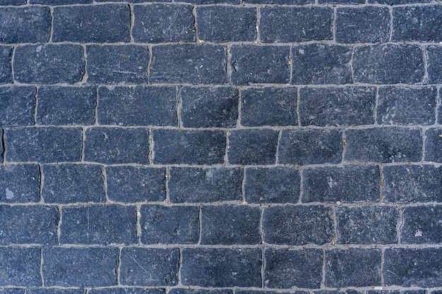 Cobblestone pavement road with edge courses at the sidewalk texture Free Photo