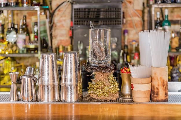 Cocktail bar equipment on a counter Premium Photo
