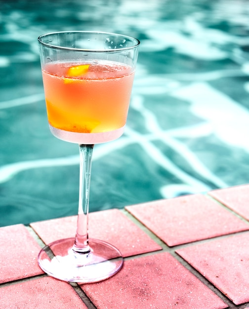 Cocktail drink by the pool Free Photo