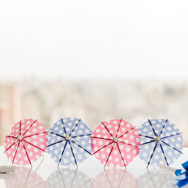Cocktail umbrellas on table Free Photo