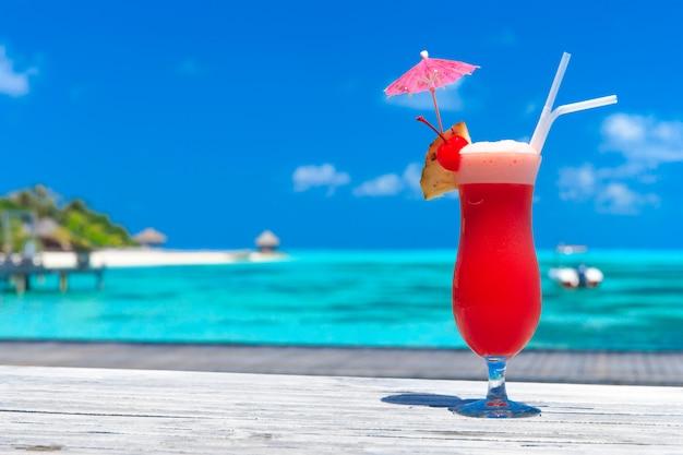 Cocktail with blur beach on background Premium Photo