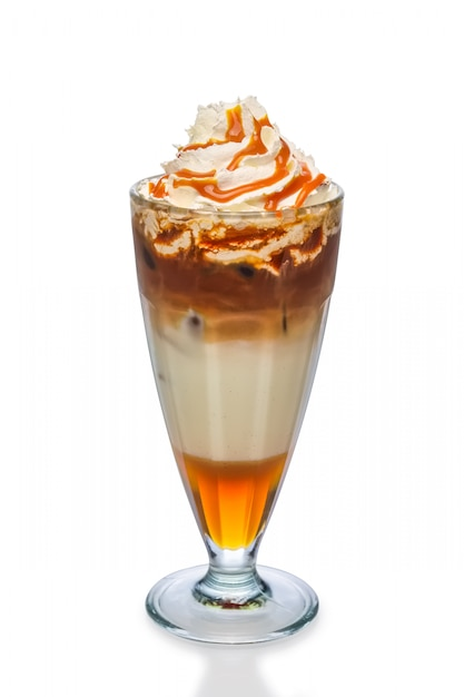 Cocktail with coffee, caramel syrup and whipped cream isolated on white Premium Photo