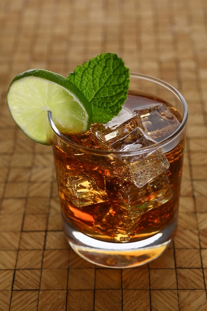 Cocktail with cola and mint Premium Photo