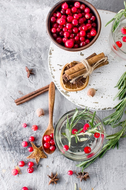 Cocktail with cranberry, rosemary and ice Premium Photo