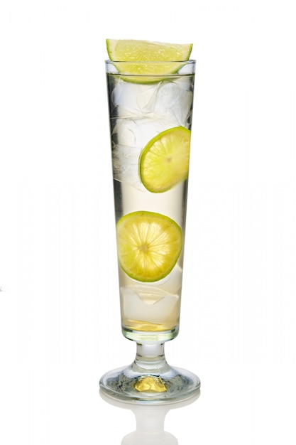 Cocktail with sparkling wine, lime and lemon in sling glass isolated on white Premium Photo