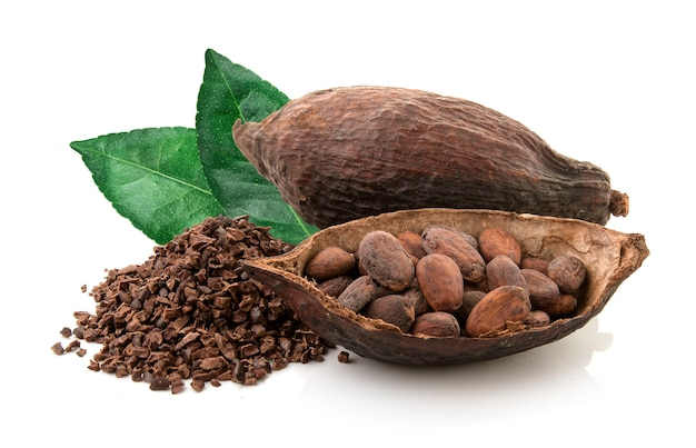 Cocoa pods and cocoa beans and cacao powder with leaves isolated on white background Premium Photo