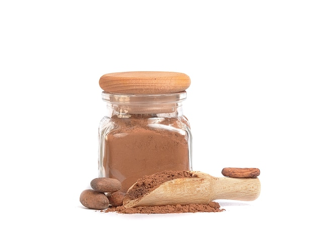 Cocoa powder in glass jar and cocoa beans Premium Photo