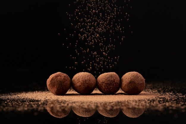 Cocoa sprinkled on truffles Free Photo