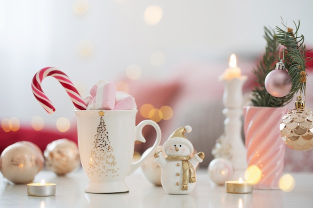 Cocoa with marshmallow  and christmas decor in pink and gold col Premium Photo