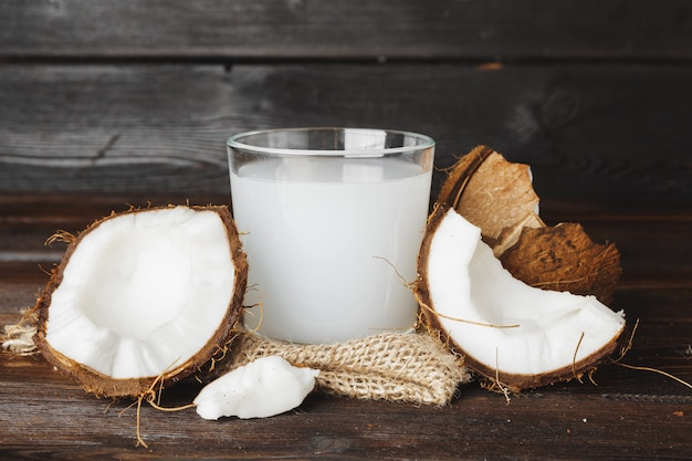 Coconut and glass jug with coconut milk Premium Photo