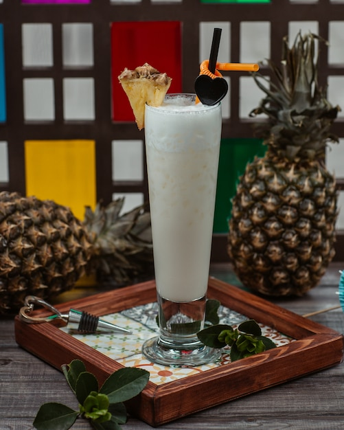 Coconut milk cocktail with pinapple slice on the top Free Photo
