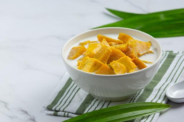 Coconut milk stewed pumpkin in white bowl Free Photo