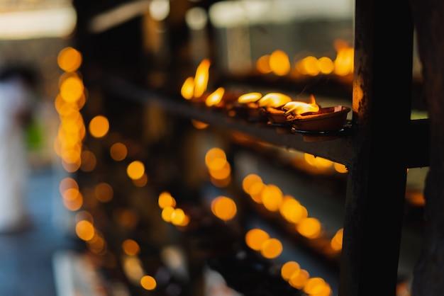 Coconut oil lamps in hindu temple Premium Photo