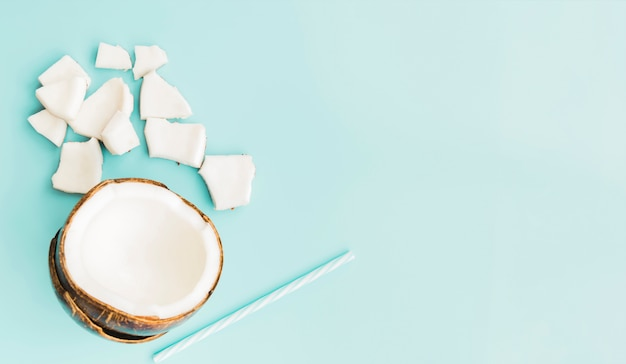 Coconut pulp and drink straw Free Photo