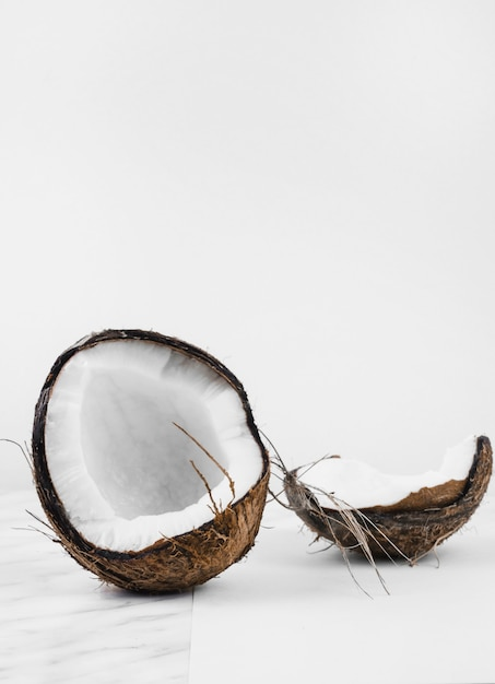 Coconut shell on white background Free Photo