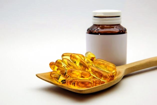 Cod liver oil capsules on white. Premium Photo