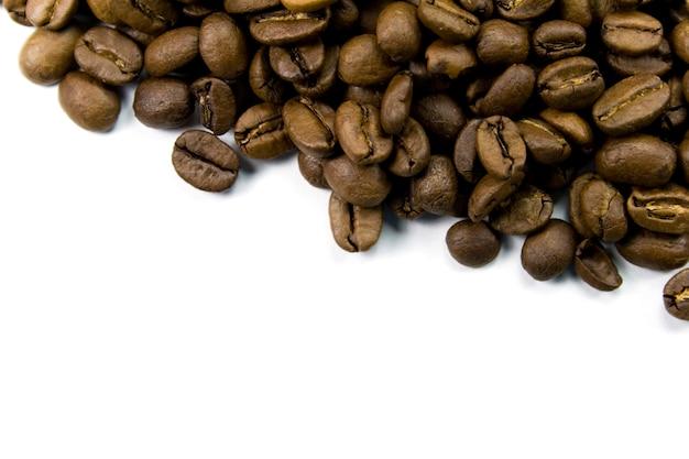 Coffe beans close-up on white Premium Photo