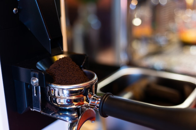 Coffe grinder in cafe. Free Photo