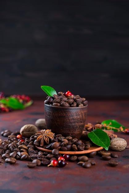 Coffee bean on black stone background Premium Photo