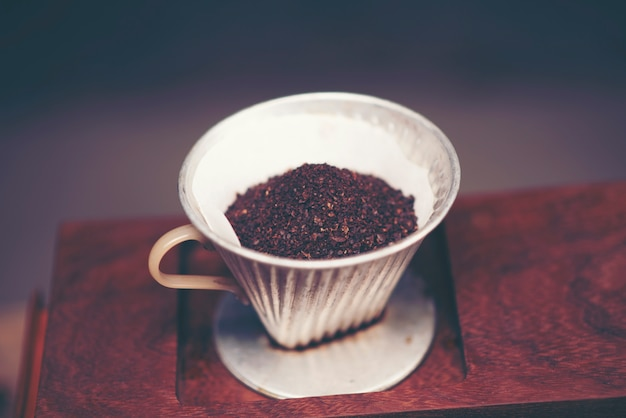 Coffee bean for drip coffee process, vintage filter image Premium Photo