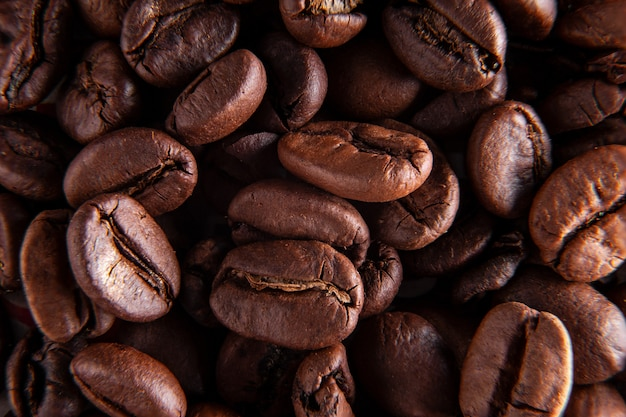 Coffee beans background. image macro good backgroud idea Premium Photo